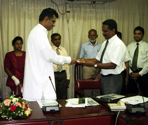 Handing over the NAP to Hon PC Ranawaka, M.P. (Left) Minister of Environment by Prof. B Marambe, Dean Faculty of Agriculture